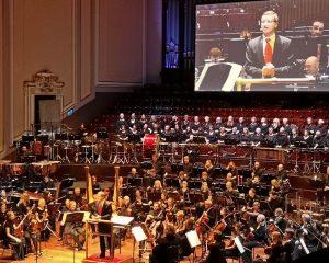 Robert Townson hosting a concert